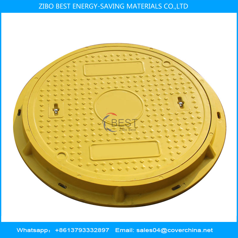 yellow manhole cover